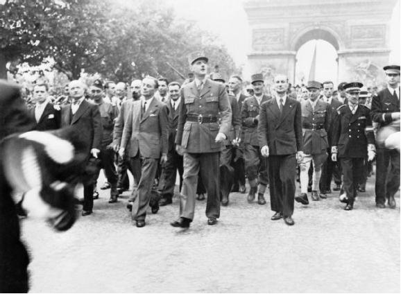 General Charles de Gaulle and his entourage set off from the Arc de Triumphe to Notre Dame for a service of thanksgiving following the city's liberation in August 1944.