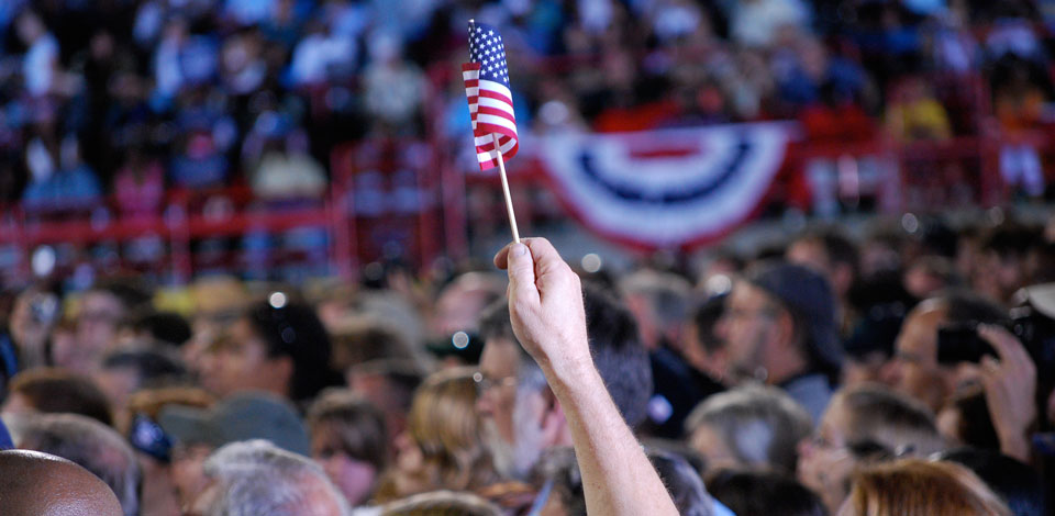 Tiny American flag in crowd at political rally