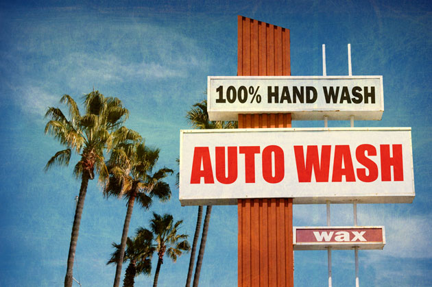 Vintage car wash sign, shaped something like a cross