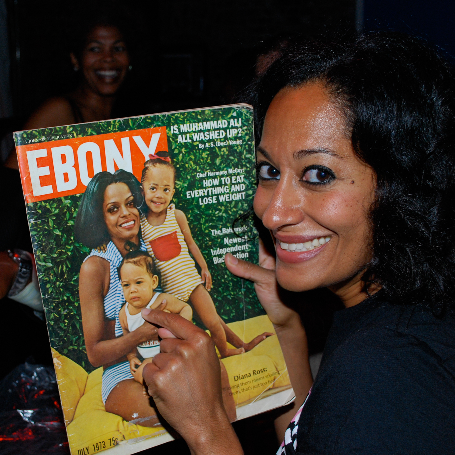Tracee Ellis Ross with photo of herself and mother Diana Ross, Detroit, 2008