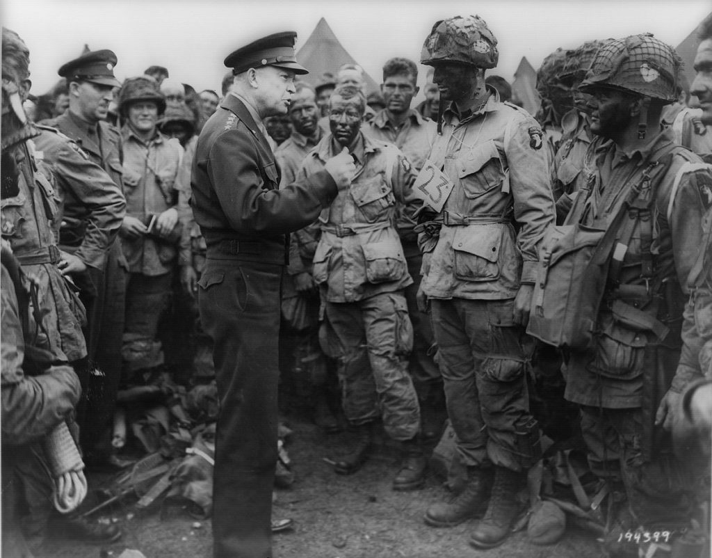 General Dwight  Eisenhower speaks with men of the 502nd Parachute Infantry Regiment, part of the 101st Airborne Division, on June 5, 1944, the day before the D-Day invasion.