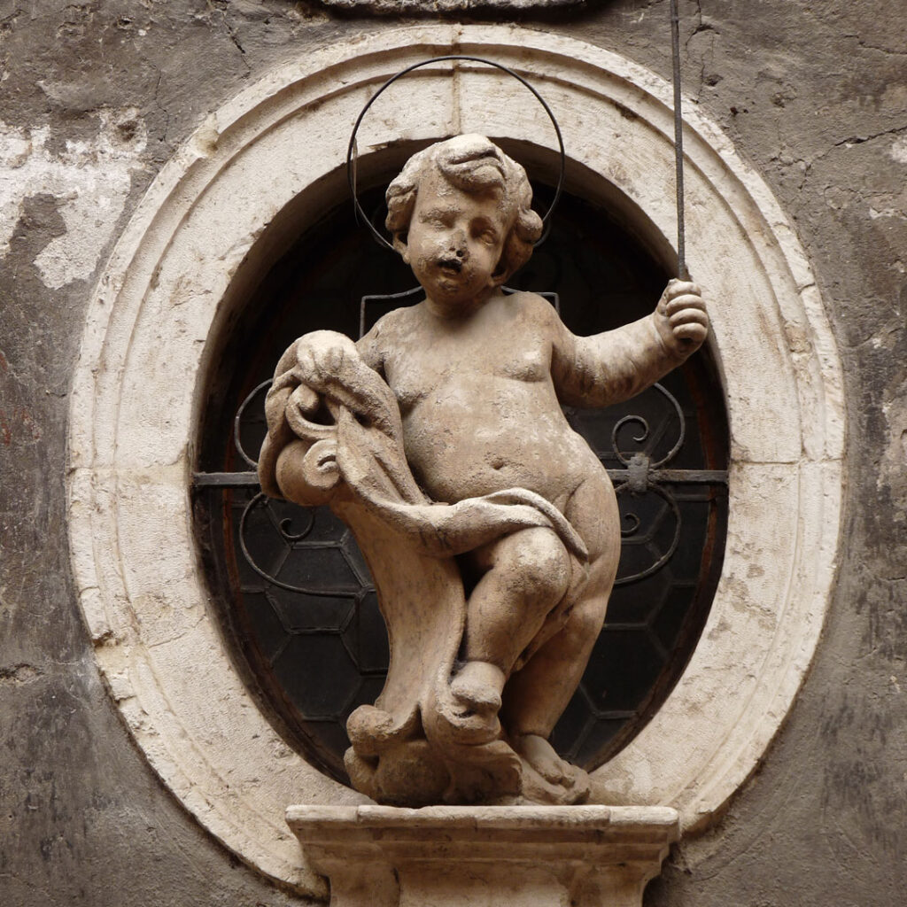 Statue of Simon of Trent on the front of the chapel dedicated to him in Trento, Italy.