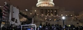 Riot police and protesters outside United States Capitol on the evening of Jan. 6, 2021
